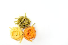 Colorful uncooked pasta - tagliatelle Stock Photos