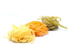 Colorful uncooked pasta - tagliatelle Stock Image