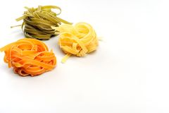 Colorful uncooked pasta - tagliatelle Royalty Free Stock Image