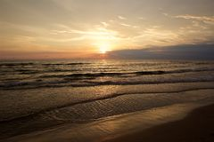 Colorful unset and the sea. Colorful sunset at the beach of the calm Baltic Sea stock images
