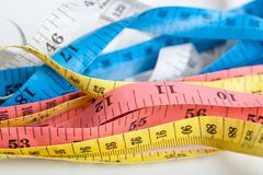 Colorful  untidy  measuring tapes Stock Images