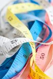 Colorful  untidy  measuring tapes Stock Image