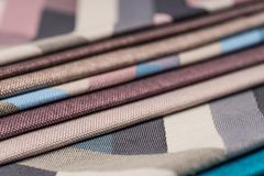 Colorful upholstery fabric samples background. Royalty Free Stock Images