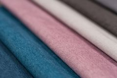 Colorful upholstery fabric samples background. Royalty Free Stock Photography