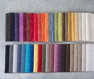 Colorful upholstery fabric samples in the store. Stock Image
