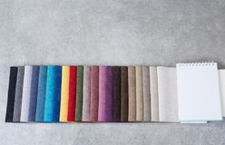 Colorful upholstery fabric samples in the store. Royalty Free Stock Photos