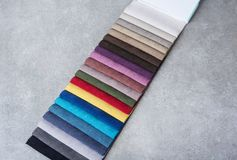 Colorful upholstery fabric samples in the store. royalty free stock image