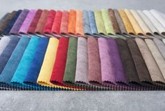 Colorful upholstery fabric samples in the store. Royalty Free Stock Photography