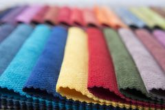 Colorful upholstery fabric samples in the store. Royalty Free Stock Photo
