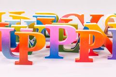 Colorful uppercase english letters. On white background royalty free stock images