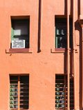 Colorful urban building. Alley view, back of a colorful old apartment building stock image