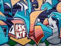 Colorful urban graffiti. Conceptual art or prejudice?. Colourful graffiti on urban wall in Thailand, urban art of vandalism Stock Images