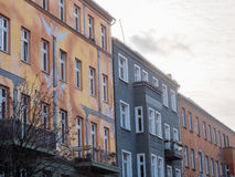 Colorful Urban Low Rise Buildings with Cloudy Sky. Architectural Detail of Urban Low Rise Buildings with Colorful Mural Facades and Balconies with Overcast Sky Stock Photos