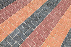 Colorful urban roadside pavement background texture. Colorful urban roadside pavement background photo texture stock photos