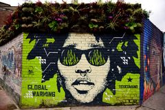 Colorful urban street art, male portrait in Colombia. Colombian mural or street art, man portrait wearing sunglasses in Bogota, Colombia, South America stock photography