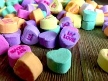 Colorful valentine`s day candy hearts stock photo