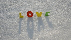 Colorful Valentine word love on February snow Stock Photo