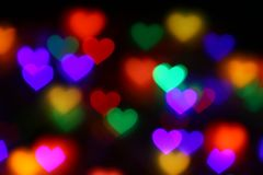 Valentines Colorful heart-shaped bokeh on black background lighting bokeh for decoration at night wallpaper blur valentine Royalty Free Stock Photography