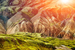 Colorful valley in rhyolite mountains near Landmannalaugar, Iceland. Valley National Park Landmannalaugar. On the gentle slopes of the mountains are snow fields Stock Photography