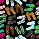 Colorful variation of flip flops summer shoes dark seamless pattern eps10 Royalty Free Stock Image