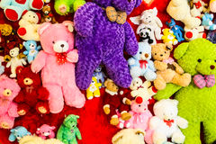 Variety of bears. Colorful variety of bears on red wall Stock Photography
