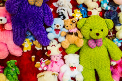Variety of bears. Colorful variety of bears on red wall Royalty Free Stock Photography