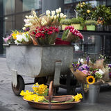 Colorful variety of flowers in iron trolley Stock Photo