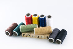 Colorful variety of threads and wooden cubes forming the word colors Royalty Free Stock Photos