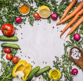 Colorful various of organic farm vegetables lined frame on wooden rustic background top view place text Royalty Free Stock Photos