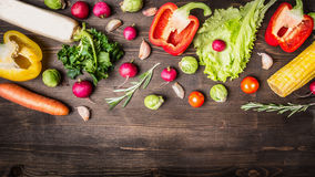 Colorful various of organic farm vegetables peppers, carrots, daikon, lettuce, radishes, corn, rosemary border ,place  text on Stock Image