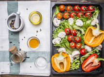 Colorful various organic farm vegetables in a wooden box and seasoning on a napkin place for text,frame on wooden rustic backgr Royalty Free Stock Photos