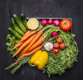 Colorful various of organic farm vegetables in a wooden box on wooden rustic background top view close up Royalty Free Stock Photography
