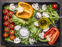 Colorful various of organic farm vegetables  in a wooden box  wooden rustic background top view close up Stock Images