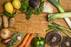 Colorful various of organic farm vegetables on wooden rustic background top view close up place text,frame Stock Images