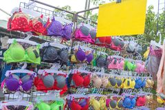 Colorful and various type of Bra sells in the market stock images