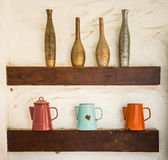 Colorful vase baked clay and steel jug put on wood shelf Stock Photography