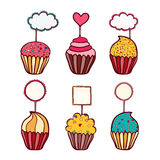 Colorful vector hand drawn doodle cartoon set of cupcakes with toppers Stock Photo