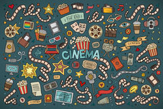Colorful vector hand drawn Doodle cartoon set of. Objects and symbols on the cinema theme Stock Photos