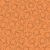 Colorful vector seamless pattern with black pumpkins outline on the orange background Stock Photos