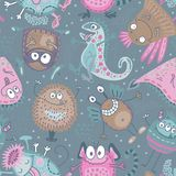 Colorful vector seamless pattern with funny monsters royalty free stock images