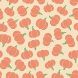 Colorful vector seamless pattern with orange pumpkins silhouettes on the beige background stock illustration