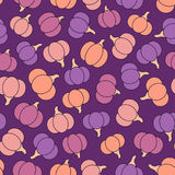 Colorful vector seamless pattern with purple, pink, yellow and orange pumpkins. Royalty Free Stock Photo