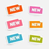Colorful Vector Stickers with New Title. Isolated on Grey Background Stock Photo