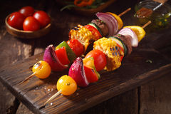 Colorful vegan or vegetarian vegetable skewers. With fresh roasted or grilled sweet peppers, onion, mushroom, corn, eggplant and cherry tomatoes, close up view Royalty Free Stock Photos