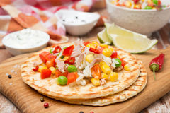 Colorful vegetable salad with tuna and cream sauce on tortillas Royalty Free Stock Photo