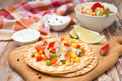 Colorful vegetable salad with tuna on wheat tortillas horizontal Royalty Free Stock Image