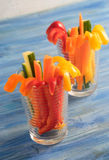 Colorful vegetable sticks in two glasses Royalty Free Stock Photography