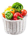 Colorful vegetables in basket isolated Stock Photos