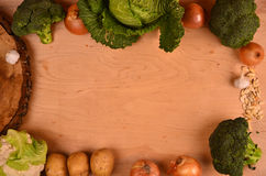 Colorful vegetables cabbage, cauliflower , broccoli, potato, onion on wooden table.  top view. free space for text Stock Photos
