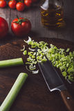 Colorful vegetables on a chopping board with knife. Preparing a salad Stock Images